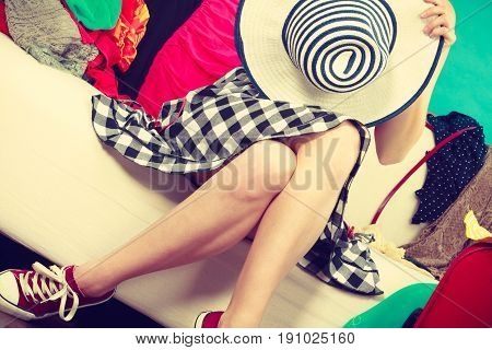 Sitting Woman Wearing Dress Holding Sun Hat