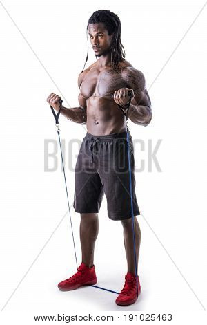 Shirtless muscular black young man exercising with elastic bands in studio, isolated on white