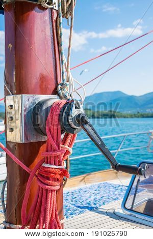 The Winch Is Attached To The Red Mast Of The Yacht. Preparation For Departure To The Open Sea.