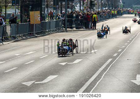 BERLIN - APRIL 02 2017: The annual 37th Berlin Half Marathon. Wheelchair competitors & hand cyclists.
