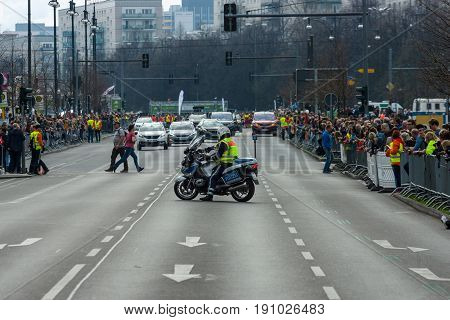 BERLIN - APRIL 02 2017: The annual 37th Berlin Half Marathon. Ensuring public order. The police are at work.