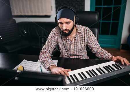 Sound producer in headphones work in studio