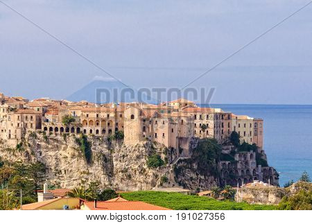 Tropea a famous bathing place situated on a reef in the gulf of St. Euphemia with the Aeolian Island Lipari in the background - Calabria Italy