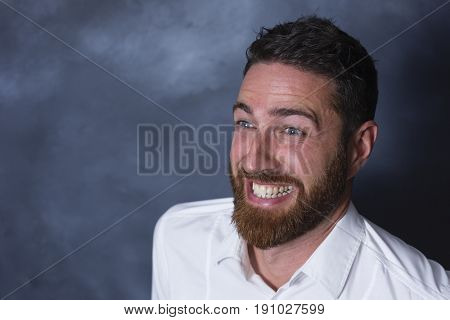 Portrait of a happy and cheerful man with a red beard 40 years old on a neutral background