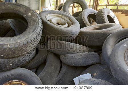 Pile Of Old Tires In Shed