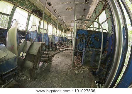 Peeling Seats And Debris Inside Abandoned Trolley Car