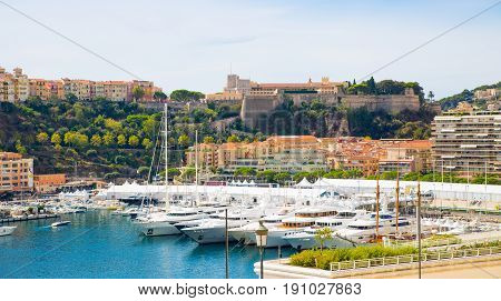 Monaco, Monte Carlo - September 17, 2016: Monaco marina with  luxury yachts, sail boats  and the Rock of Monaco view  at the background
