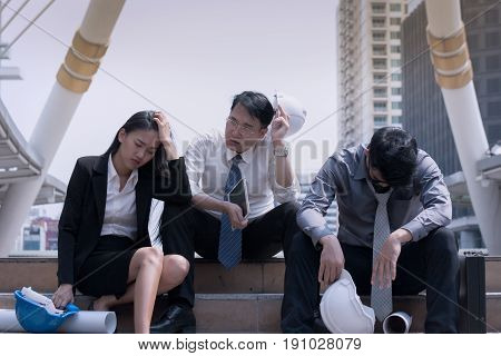 Asian Businessman And Woman Engineer Architect Professional Group Failed Or Upset Project Plan Or Jo