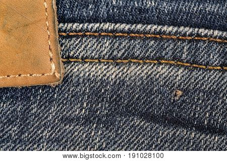 Jeans leather label close up background and textured