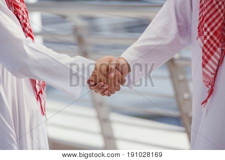 Two Arabian Business Men Shake Hand And Discuss Together For Success Concept