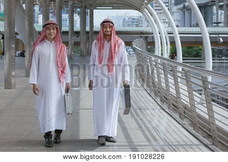 Two Arabian Businessman With Briefcase And Walk Together Around Modern City
