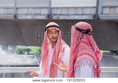 Two Arabian Businessman Discuss, Advise And Walk Together Around Modern City