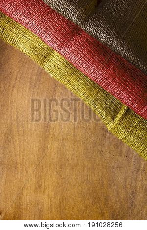 Three-color flag of Germany on a wooden background.