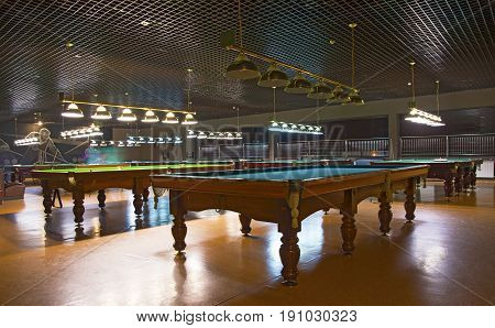 billiard Club, without people. tables, cue balls and bulbs. billiard tables in lighting lamps