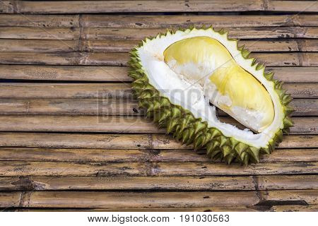 Fresh Cut Durian pulp on bamboo table top background, king of fruit in Thailand, smelly fruit in the world