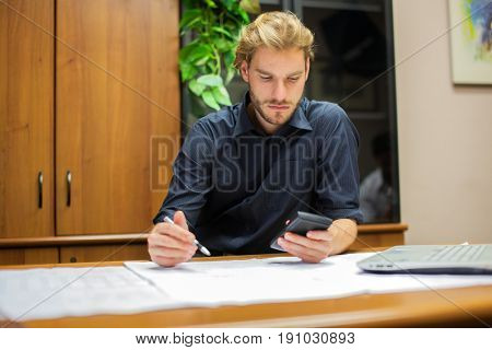 Portrait of a man at work in his office