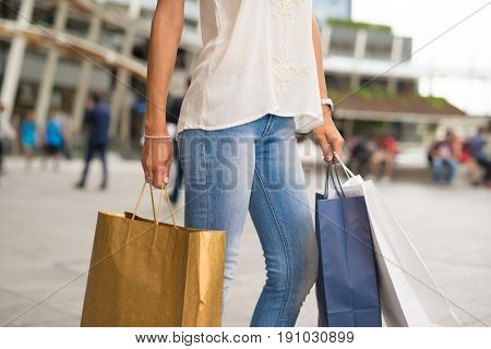 Closeup of a woman holding shopping bags