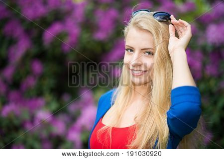 Smiling woman outdoor fashion portrait