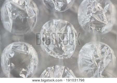 Macro shot of transparent cellophane with pimples. Packaging material and remedy for depression.