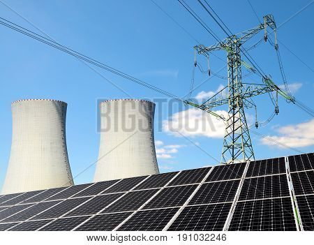 Solar panels, nuclear power plant and electricity pylon. Energy resources concept.