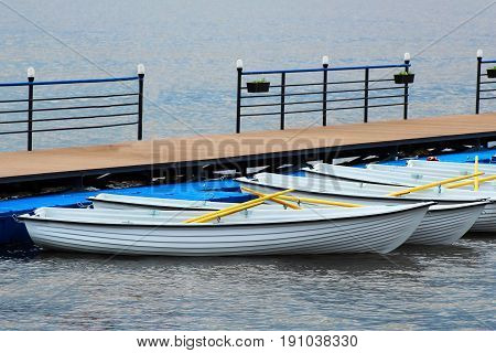 Pleasure Boats At The Pier To The Boat Station