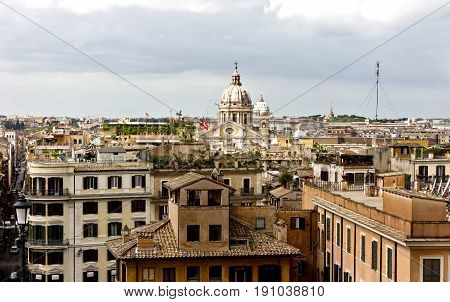 Rome, Italy - April 18, 2017: view of people and Piazza di Spagna from piazza della Trinita dei Monti. Piazza di Spagna is one of the most famous squares, it owes its name to the Palazzo di Spagna