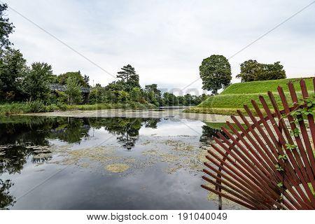 Pond in Churchill Park in Copenhagen Denmark a cloudy day of summer