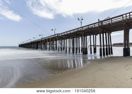 Ventura beach and pier with motion blur water in Southern California.