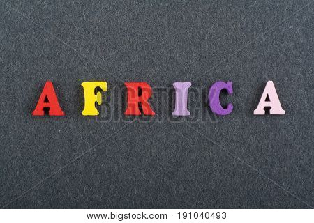AFRICA word on black board background composed from colorful abc alphabet block wooden letters, copy space for ad text. Learning english concept