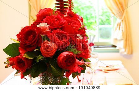 Spectacle of decoration of red roses in the room