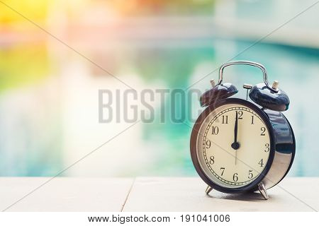 12 O'clock Retro Clock At The Swimming Pool Outdoor Holiday Time Concept.