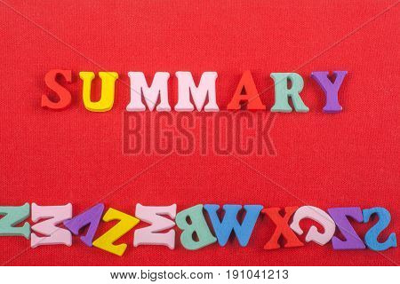 SUMMARY word on red background composed from colorful abc alphabet block wooden letters, copy space for ad text. Learning english concept