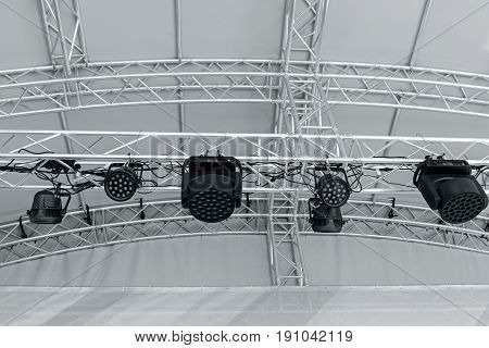 Stage Light Equipment Before Concert. Spotlights On Stage Lighting Rig.