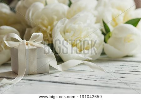 Bouquet Of White Peonies And Present Box On The Wooden Table