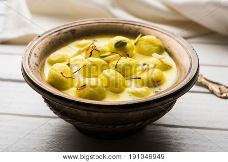 Angoori rasmalai or anguri ras malai is an Indian dessert. Made from cottage cheese which is then soaked in chashni, a sugary syrup, and rolled in fine sugar to form grape-sized balls. selective focus