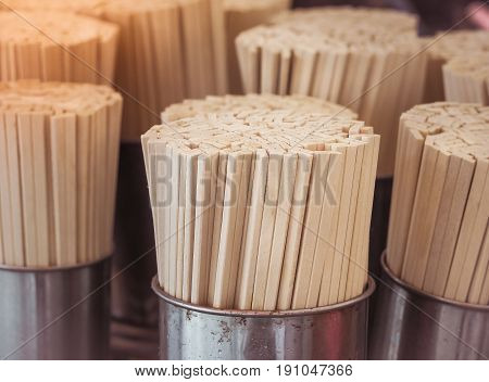 Wooden Chopsticks arranged in silver cup, Selective focus with vintage color filter
