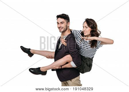 Young Casual Couple Fooling Around And Doing Piggyback Isolated On White