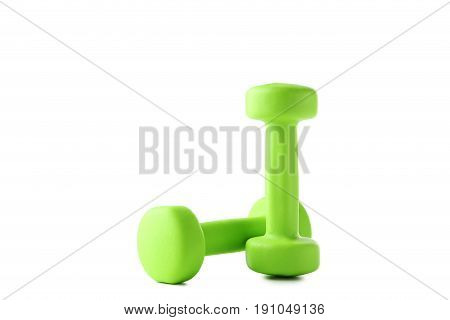 Green dumbbells isolated on a white background