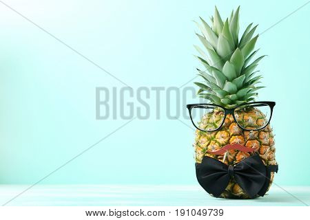Ripe Pineapple With Glasses And Bow Tie On Mint Background