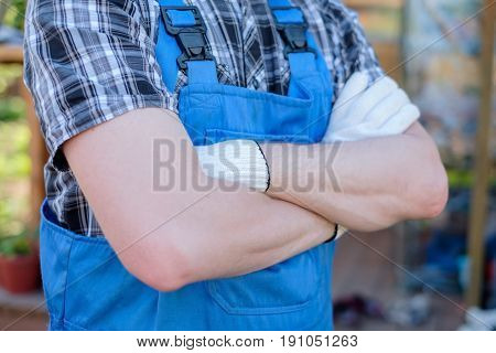 Young gardener in dungarees ready for work