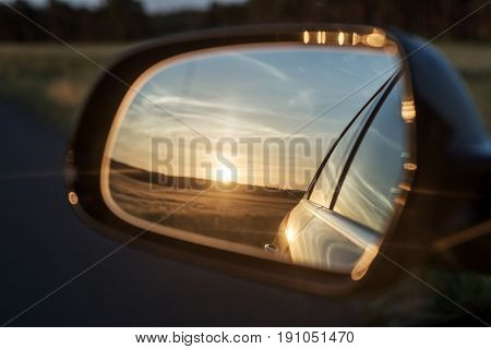 Sunrise in the rear mirror, Landscape in the rear mirror