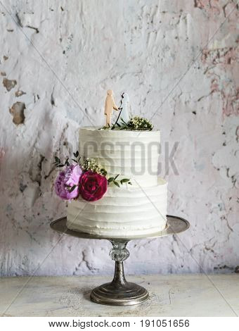 White Wedding Cake with Bride and Groom Figure Topper