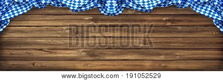 Rustic background for Oktoberfest with Bavarian white and blue fabric on old wooden board