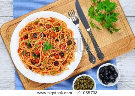 Spaghetti With Capers. Olives, Anchovies, Tomato Sauce