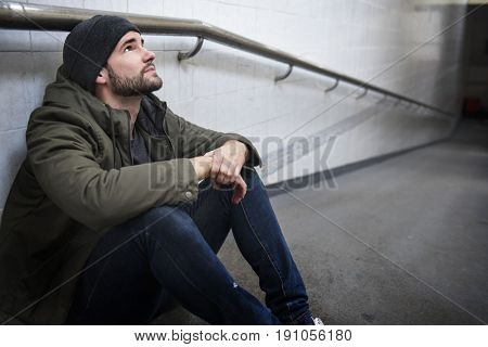 Hopeless Man Sitting Thoughtful on The Floor