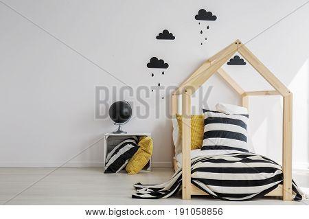Monochromatic decoration of stylish minimal kid room