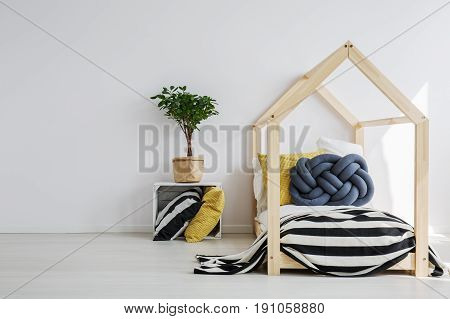 Stylish toddler's room with wooden house bed