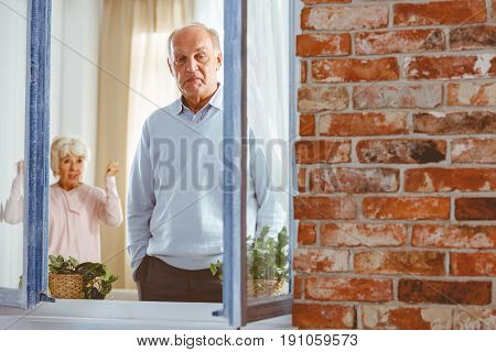 Senior elegant woman shouting at man in apartment