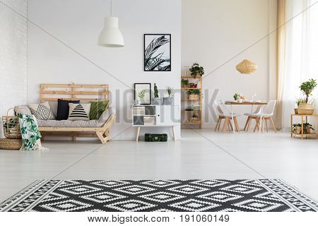 Ethnic and simple living room with dining space