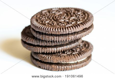 brown pile of biscuits on white background